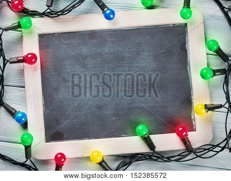 Christmas chalkboard and lights. Top view with copy space for your text