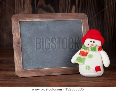 Christmas chalkboard and snowman. View with copy space for your text