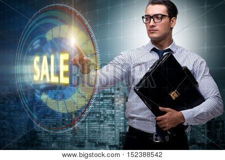 Businessman pressing buttons in sale concept