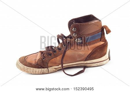 Old brown sneakers isolated on white background