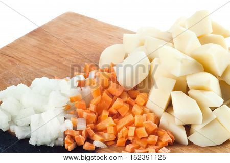 Chopped vegetables on the kitchen blackboard isolated on white background