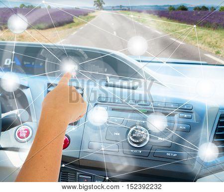 Self-driving car concept - someones hand programming modern car