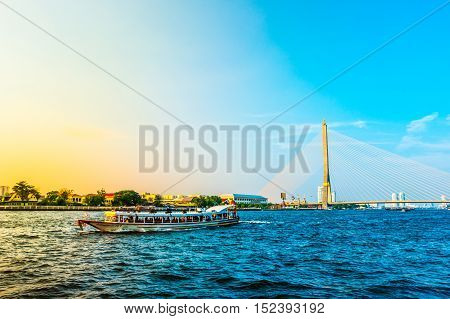 Cityscape of Bangkok viewed across Chopraya river at sunset, Thailand