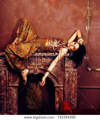 portrait of beauty sensual young woman in oriental style in luxury room, pakistani people concept close up