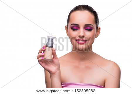 Woman with a bottle of cream isolated on white