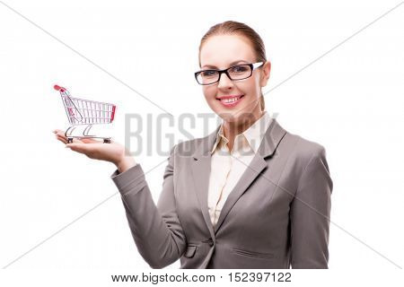 Businesswoman with shopping cart trolley isolated on white