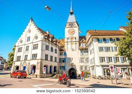 Zug, Switzerland - June 28, 2016: View on the city gate and clock tower in Zug town near Zurich city in Switzerland