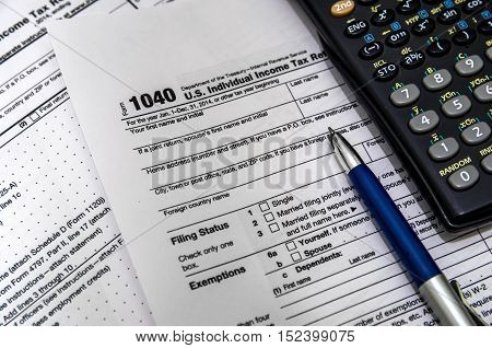 US tax form 1040 with pen and calculator.