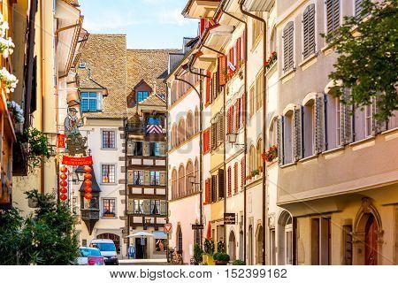 Zug, Switzerland - June 28, 2016: Beautiful colorful buildings in Zug village near Zurich city in Switzerland.