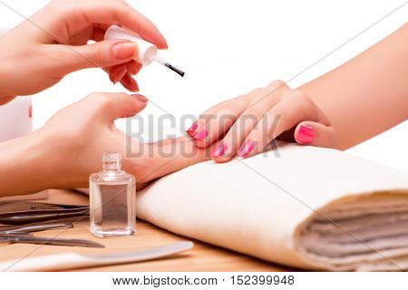 Young woman in nail treatment medical concept