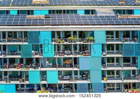 Zurich, Switzerland - June 28, 2016: Modern residential building's facade with solar panels in Oerlikon district in Zurich in Switzerland