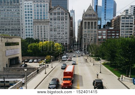 Chicago USA - September 24 2015: People and cars on the street of Chicago Illinois
