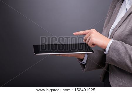 Woman with tablet computer in business concept