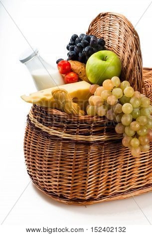 Cheeses, Apple, Grape, Bread, Tomatoes and Milk in the Picnic Basket
