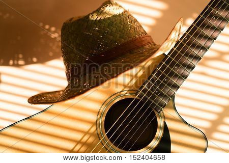 Straw Hat on the Guitar - Close Up