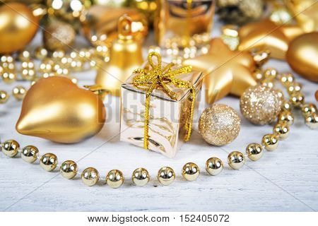 Brilliant gold baubles and cones like christmas decoration. Yellow balls ribbon gift bow and tinsel isolated on white background.