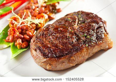 Beef Steak with Red Bean Garnish