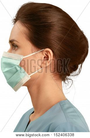 Female healthcare worker wearing a face mask and scrubs