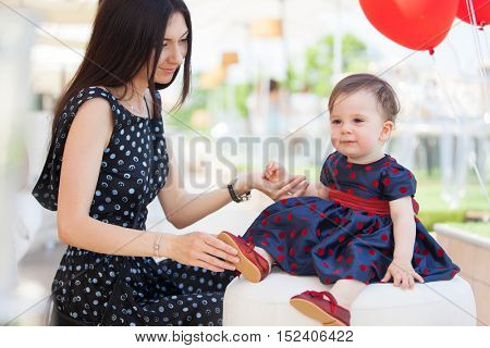 Happy family, mother and daughter  celebrating child's birthday. Happy family concept