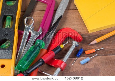 Closeup Working Tools. Set Of Working Tools On Wooden Background. Wood Working Tools Background Conc