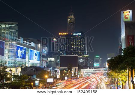 Bangkok Thailand - October 13 2016: Siam square night view with light trails. This square is famous shopping area in Bangkok