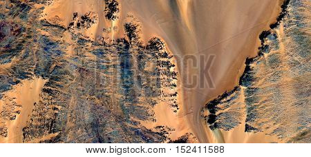 Abstract photography of landscapes of deserts of Africa from the air, toast sand