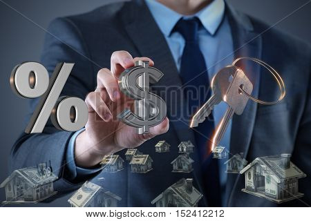 Young handsome businessman in mortgage concept