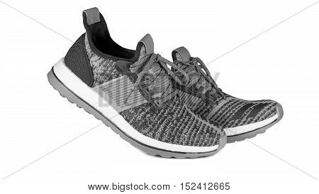 Shoes and sport concept - Sport running shoes gray black and white tone color isolated on white background