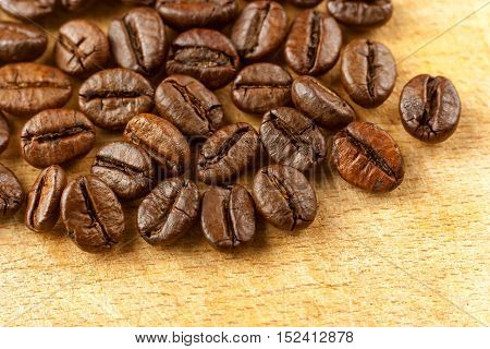 Fresh roasted coffee beans on a wooden board