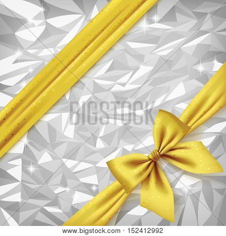 Gold ribbon and bow on bright silver foil texture background. Gift package and greeting card