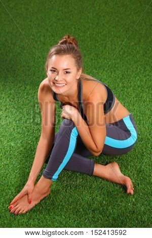 Portrait of sports woman relaxing outdoors after workout