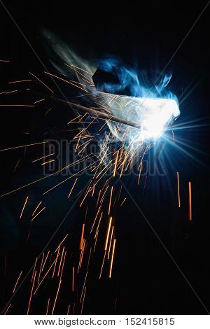 Welding steel structures and bright sparks with len flare in steel construction industry.