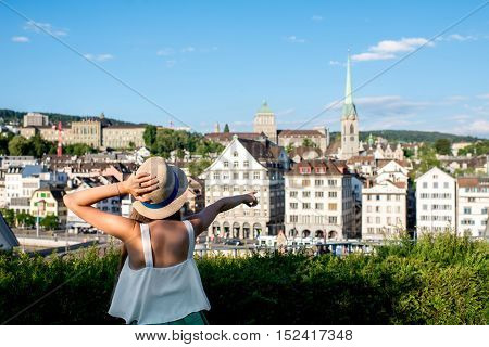 Young female tourist enjoying the beautiful old townscape view in Zurich city. Having a happy vacation in Switzerland