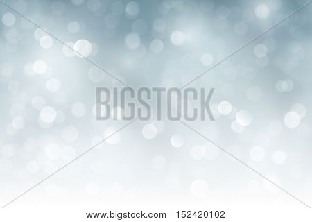 Light effects and sparkling out of focus lights for a magical abstract silver backdrop for Christmas or any other festive occasion