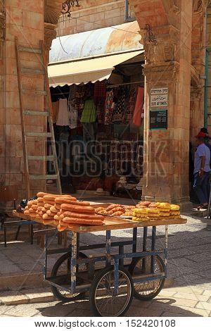 JERUSALEM, ISRAEL - AUGUST 23, 2016: Cart of bread in the streets of Old Jerusalem, Israel. Vertical image, selective focus.