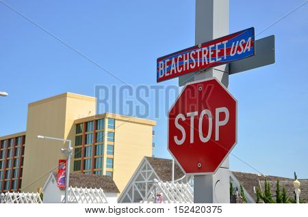 VIRGINIA BEACH, USA - MAY 4: Beach Street USA Sign and Stop Sign in Virginia Beach Oceanfront on May 4th, 2012 in Virginia Beach, Virginia, USA.