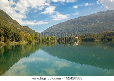 TRENTO, ITALY - SEPTEMBER 2016 : Castel Toblino at beautiful Lago di Santa Massenza Lake in Santa Massenza, Trento during Autumn season in Italy, Europe on September 24, 2016.