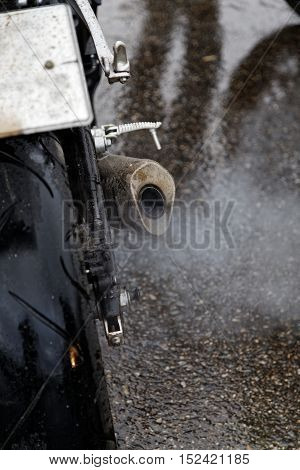 Exhaust Pipe And Rear Wheel Of Motocicle