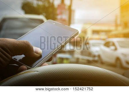 Driving while holding a mobile phone /Cell phone use while driving / Vintage concept