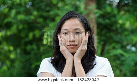South East Asian Girl Looking Away Green Background