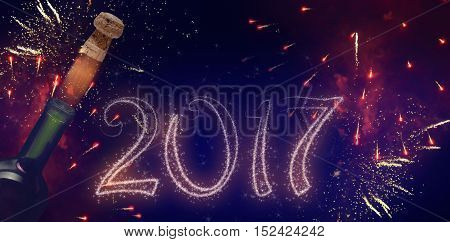 Beautiful new year banner with fireworks text and champagne, for celebration of 2017
