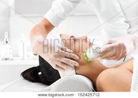 Ultrasound, a woman in the beauty salon Phototherapy, a woman in the beauty salon