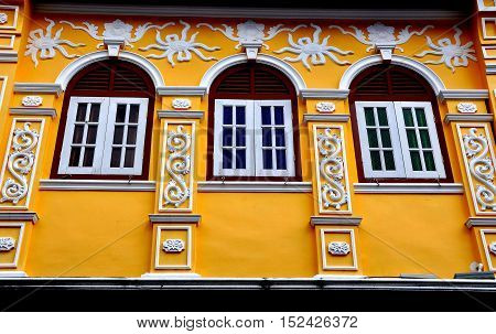 Phuket City Thailand - January 8 2011: Ornate facade of a restored late 19th century Sino-Portuguese Chinese shop house on Soi Rommanee