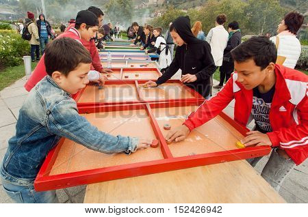 TBILISI, GEORGIA - OCT 16, 2016: Unidentified boys having fun during passion game on the children playground of Tbilisoba on October 16, 2016. Tbilisi has a population of 1.5 million people