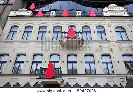 Kaunas, Lithuania - January 7, 2016: The facade of a historic building in Kaunas decorated with stylized red Christmas trees.