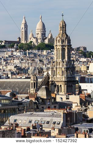 Panorama of Paris: The Sainte-Trinite and Sacre-Coeur churches. View of Paris from the roof of department store