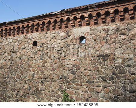 Detail of an old stone wall of the castle in Vyborg