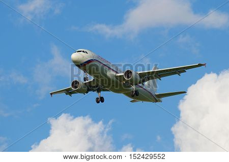 SAINT PETERSBURG, RUSSIA - JULY 24, 2015: Departing clouds the aircraft Airbus 320 (EI-FAJ) of airline