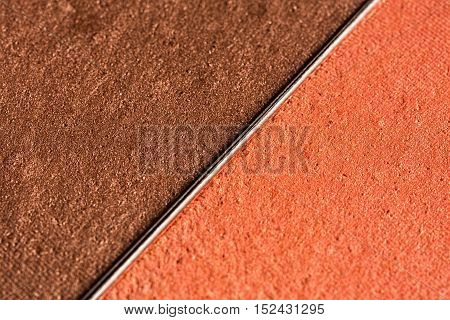 Macro shot of a bronze make up powder.