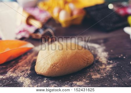 Dough for Christmas cookies on a wooden background